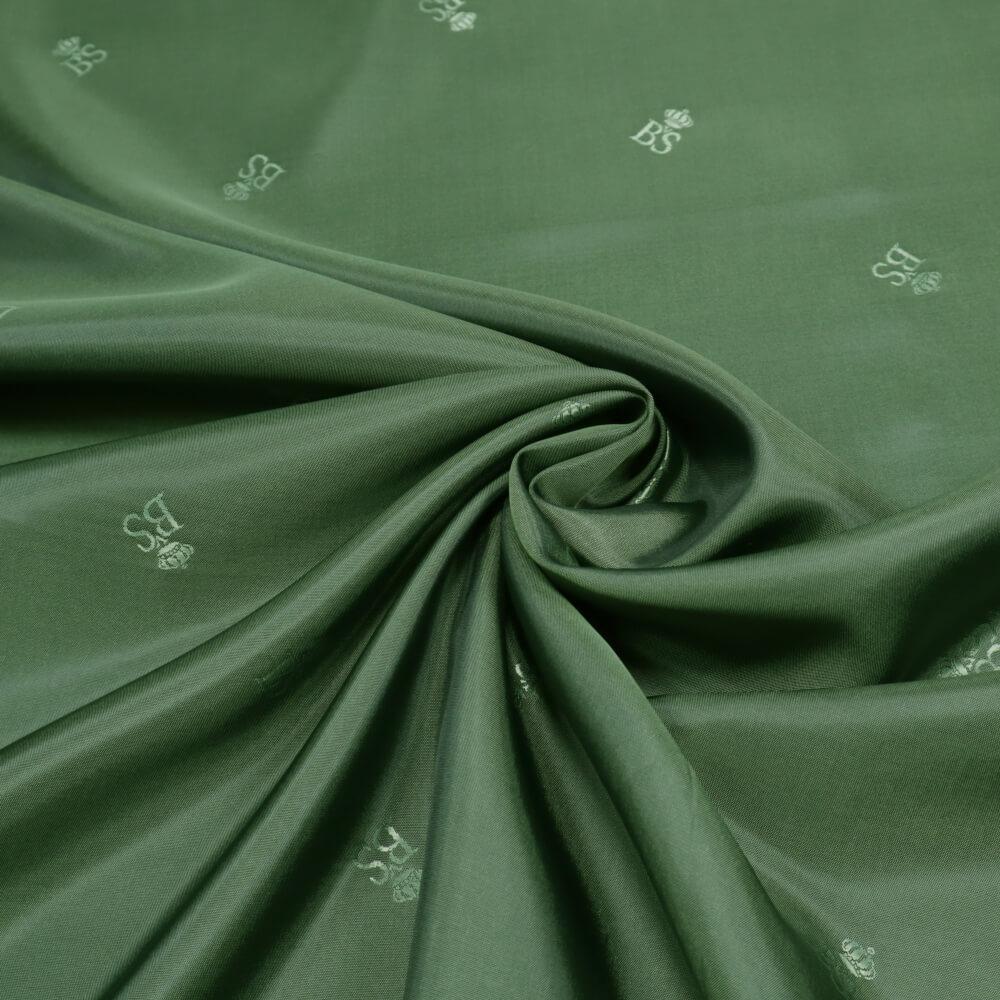 0,5m | Futterstoff 140cm Breit aus 100% Polyester Logo-Muster & Changierend - grün/schwarz  (10456)
